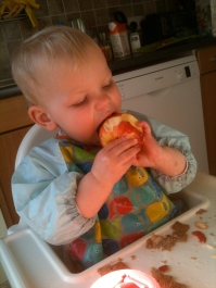 Mandy's little girl tucking into an apple...